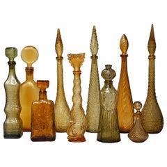 Ten 1960s Vintage Italian Amber Glass Empoli 'Genie' Decanters Liquor Bottles