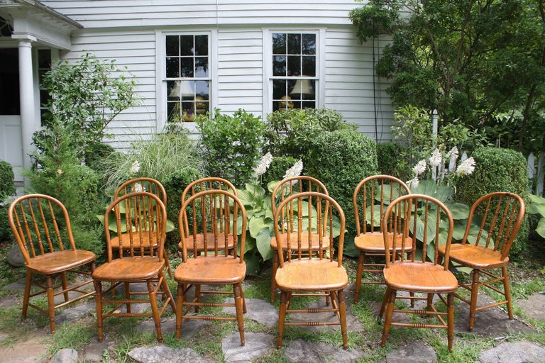 A set of ten 'hoop back' or 'sack back' Windsor side chairs, with pipe stem spindles.  Made in Litchfield County, Connecticut and used by the Swedish Congregational Church; as it was known at the time. The top ring turnings on the spindles of four