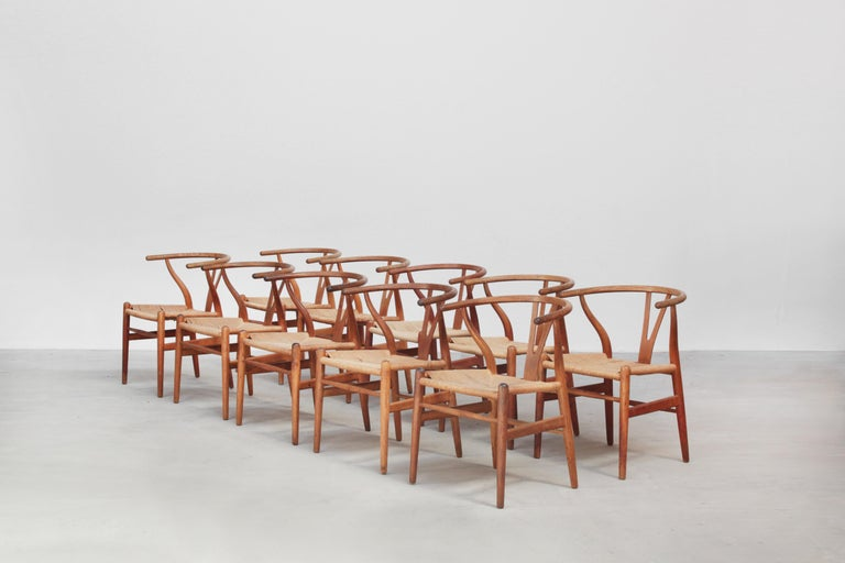A set of ten beautiful and original wishbone chairs designed by Hans J. Wegner and produced by Carl Hansen in the 1960s in Denmark. All chairs are made out of oak and in a beautiful original condition with signs of usage like little stains, dirt,