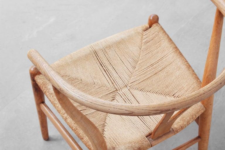 Ten Danish Vintage Wishbone Chairs CH 24 by Hans J. Wegner for Carl Hansen Oak For Sale 3