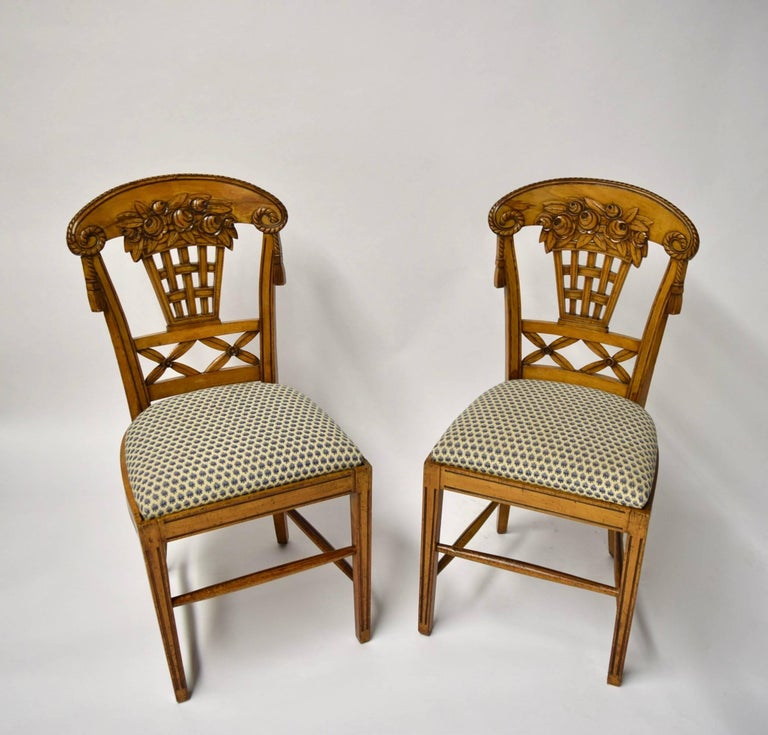 Set of ten beautiful fruitwood dining chairs by André Groult designed in 1912; the set comprises eight side chairs and two armchairs, all with fine woodwork and carved elements throughout. The chairs have backrests that are slightly curved and