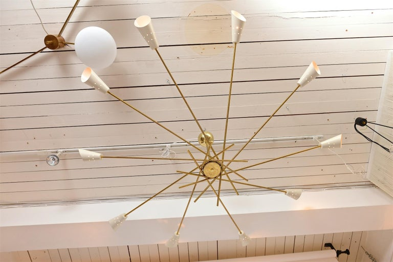 Brass and painted aluminium chandelier with 10 lights  Contemporary Sputnik like take on the style of 1950s Italian lights commonly attributed to Stilnovo  Drop can be as required with minimum at 45cm  Closes just like an umbrella for easy