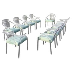 Ten Lucite Dining Chairs