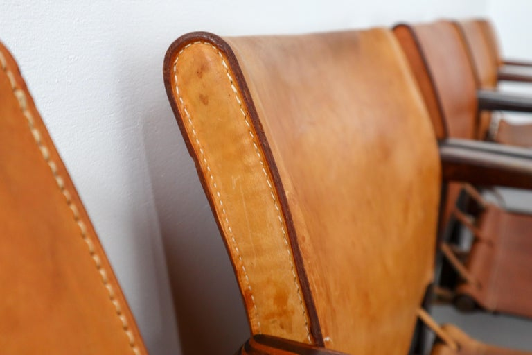 European Ten Midcentury Safari Lounge Chairs in Patinated Cognac Saddle Leather, 1970s For Sale