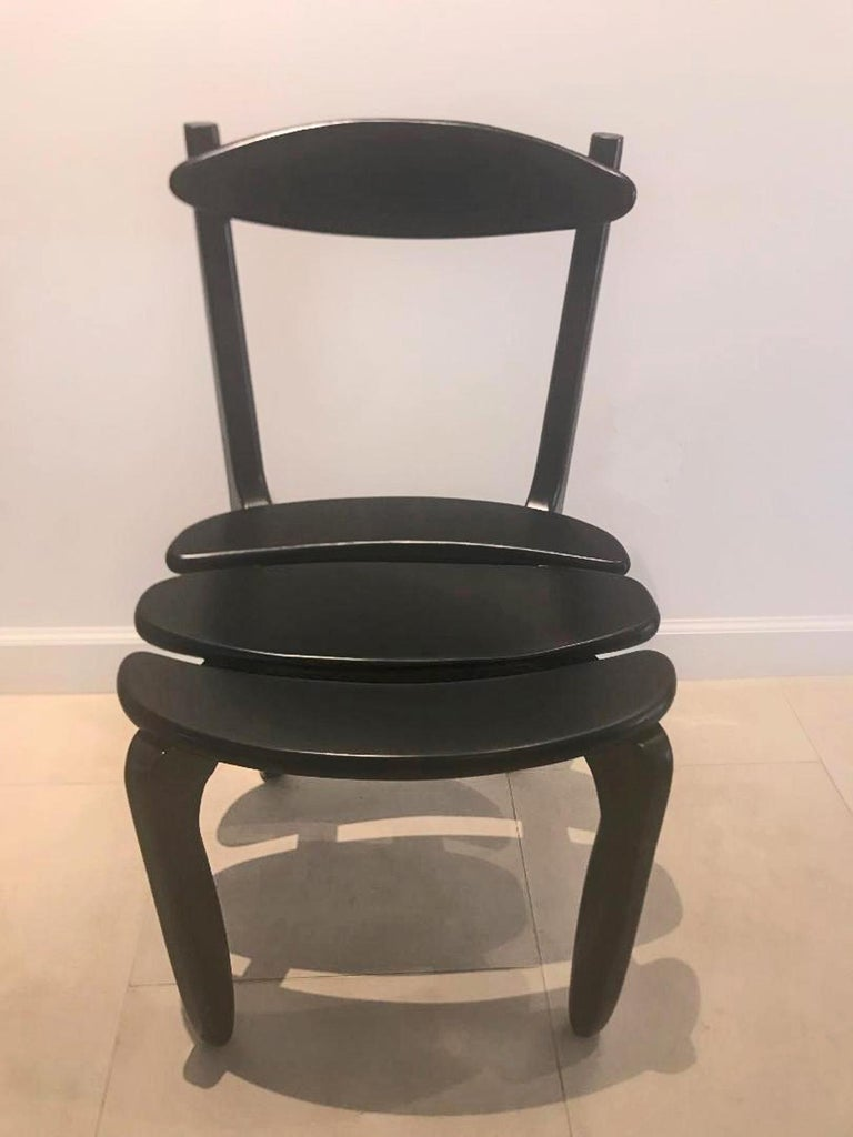 Suite of ten black stained oak dining room chairs. Guillerme and Chambron Edition Votre Maison.