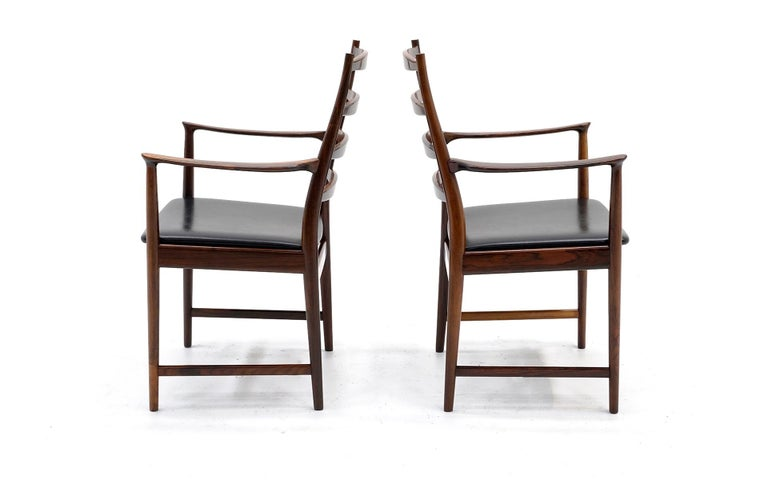 Norwegian Ten Solid Rosewood Dining Chairs, Torbjørn Afdal, Two Arm and Eight Side Chairs For Sale