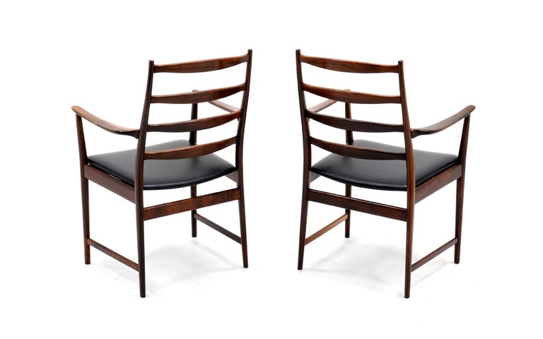 Ten Solid Rosewood Dining Chairs, Torbjørn Afdal, Two Arm and Eight Side Chairs In Good Condition For Sale In Kansas City, MO