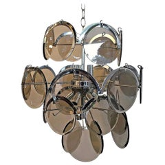 Ten Torchère Multi Smoked Beveled Glass Discs and Chrome Plate Frame Chandelier