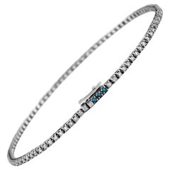 Tennis Bracelet in White and Blue Diamonds and 18 Karat White Gold