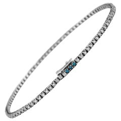 Tennis Bracelet in White and Blue Diamonds and 18 Karat White Gold