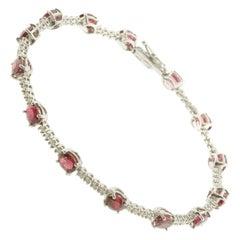 Tennis Bracelet in White Diamonds and Rubies Set in 18 Karat White Gold