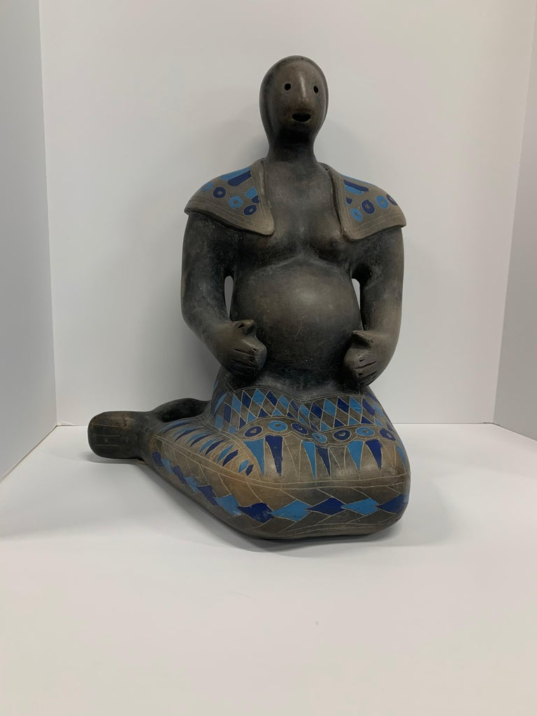 A feritilty figure likely by Max Kerlow from Teotihuacan in Mexico. Depicting a pregnant woman decorated in bright blue triangles. In good condition with minor flaws. Approximately 14 1/2 inches tall.