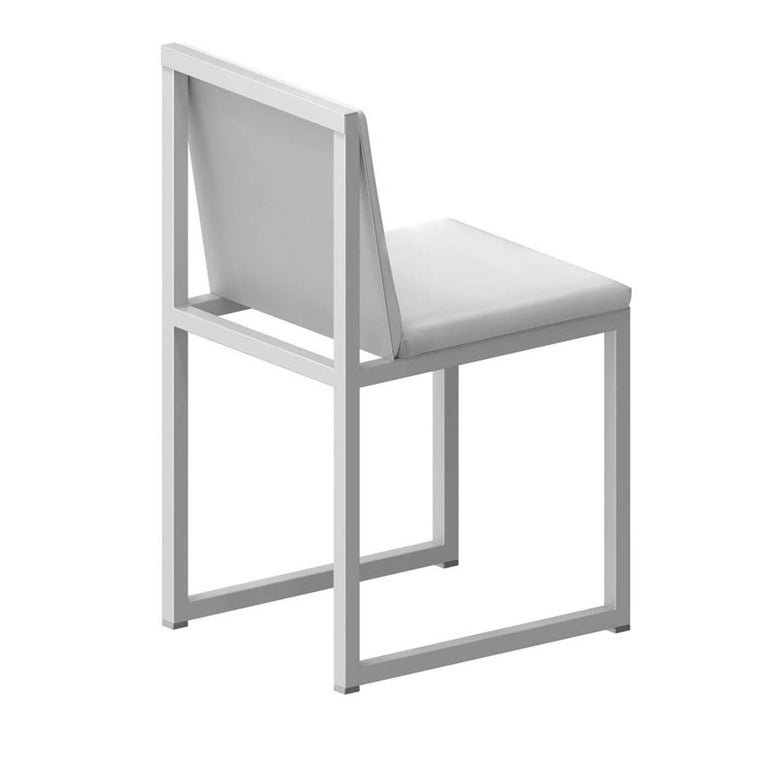 Equally suited to everyday dining or special occasions, this exclusive chair is constructed with a geometric, open frame of square steel tubing (25 x 25 mm) that gives it a minimalist and airy look. The steel sheet seat and back feature padded