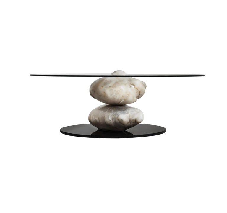 The Terra coffee table collection is composed of blocks of hand polished Alabaster Stone. The stones are carefully positioned and balanced to support a crystal base. A unique piece that reflects an organic essence and a minimalist character.  The