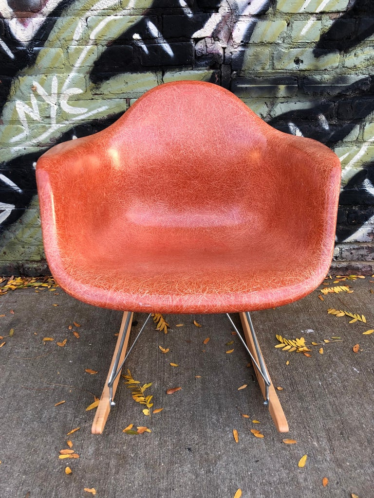 Gorgeous vintage Herman Miller Eames fiberglass armshell on new rocker base. Modern RAR. Featured in rare color terracotta. This shell has the most spectacular fibers of any Eames shell we have ever come across. Stamped Herman Miller under the