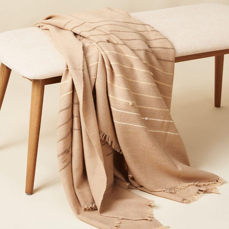 Custom design by Studio Variously, TERRA (  throw / bed spread / blanket ) is handwoven by master weavers in Nepal and dyed entirely with earth friendly dyes in  soft 100% merino yarn that is hand spun.  A sustainable design brand based out of