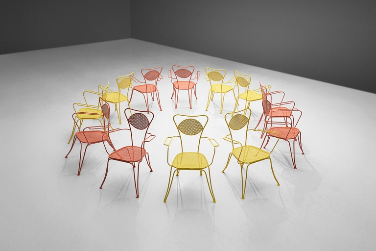 Large set of dining chairs, orange colored metal, Italy, 1960s.  Very large set of metal chairs in a vivid orange color. The chairs have an elegant, bold design, as is quintessential of Italian patio chairs. Curved shapes and thin armrests form