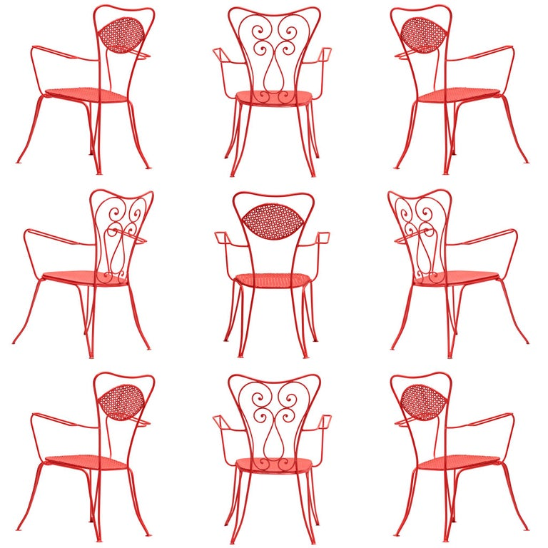 Large set of dining chairs, red colored metal, Italy, 1960s.  Very large set of metal chairs in a vivid red color. The chairs have an elegant, bold design, as is quintessential of Italian patio chairs. Curved shapes and thin armrests form the