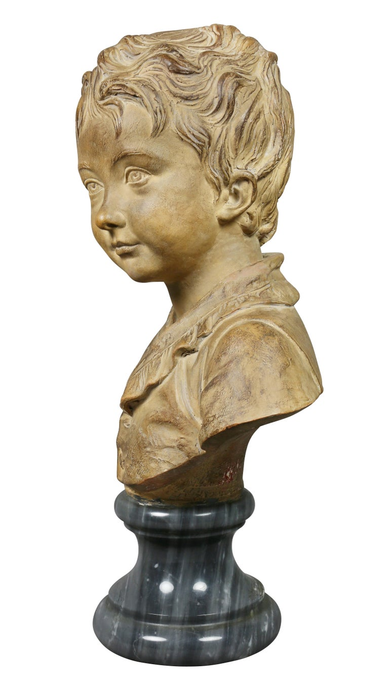 French Terracotta Bust of a Young Boy by Houdon For Sale