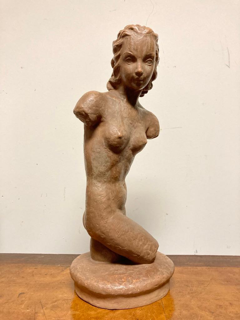 A beautiful glazed terracotta nude, shown in a contrapposto pose. She is both modern, with her stylish hair and classical, harking back to ancient Roman sculpture. Stamped Goldscheider, Wein marks.  Nice scale at 17.25 inches high 7.25 wide 6.5