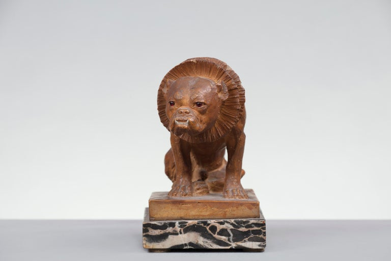 Terracotta figure of a dog, England, 19th century.
