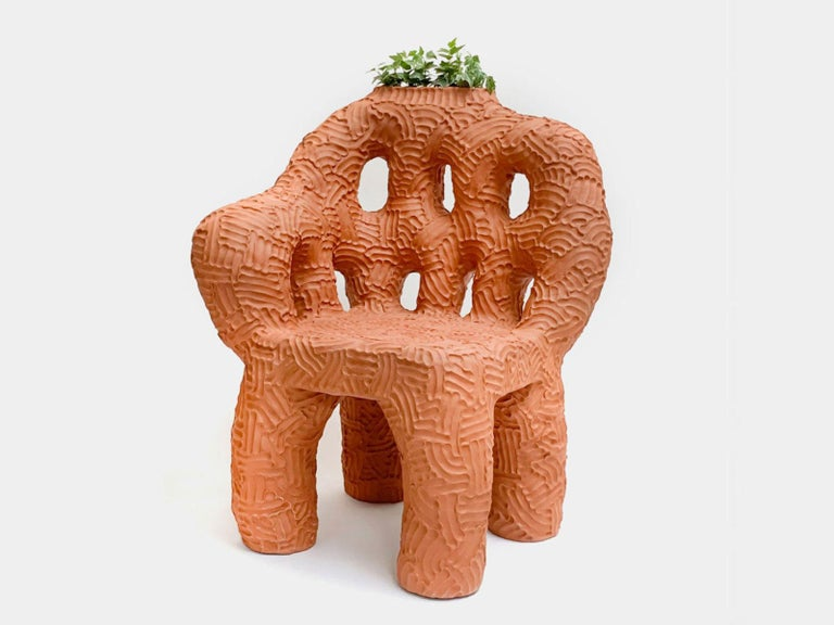 Chair and planter handmade of solid terracotta by New York and Medellín-based artist Chris Wolston. Can be used indoors or outdoors – Please note, this cannot be left outside during the winter months in environments where the temperature falls below