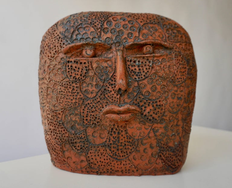 Terracotta sculpture signed. Measures: Height 24 cm. Width 23 cm. Depth 12 cm.