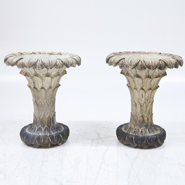 Pair of vases in the form of terracotta leaf cups, patinated in white.