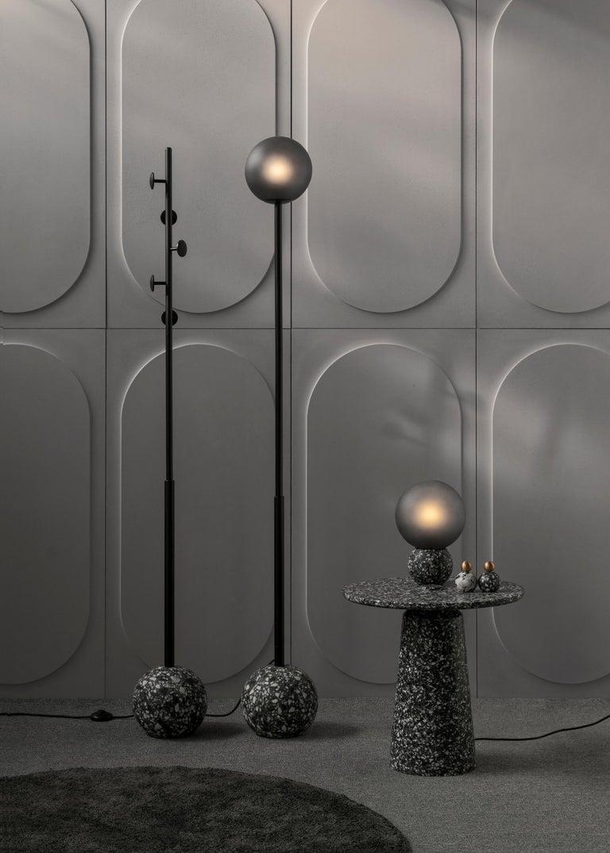 Material: Concrete, leftover stone aggregate, glass Size: Ø 200 x H 295 mm  Weight: 4 kg Cord: Black, 1.7 m Light source: E27 LED Color tempetature: 2700 K Wattafe: 3 W Voltage: 220 - 240 V Color: Black / White  About the Artist/