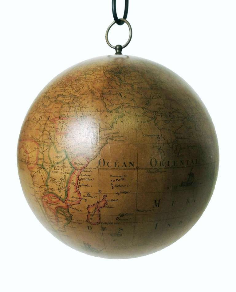 This extremely rare terrestrial swinging globe is an exceptional find. Designed, created and built to be hanged to the ceiling in order to spin and play with it. Rare are the cases of pre-revolutionary French globes, and most of all the swinging