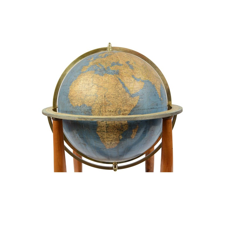 Terrestrial globe published in the 1950s by Vallardi publisher, drawn and engraved by A. Minelli, papier-mâché sphere covered with paper printed by engraving on copper plate and watercolored, walnut base with four feet complete with the circle of