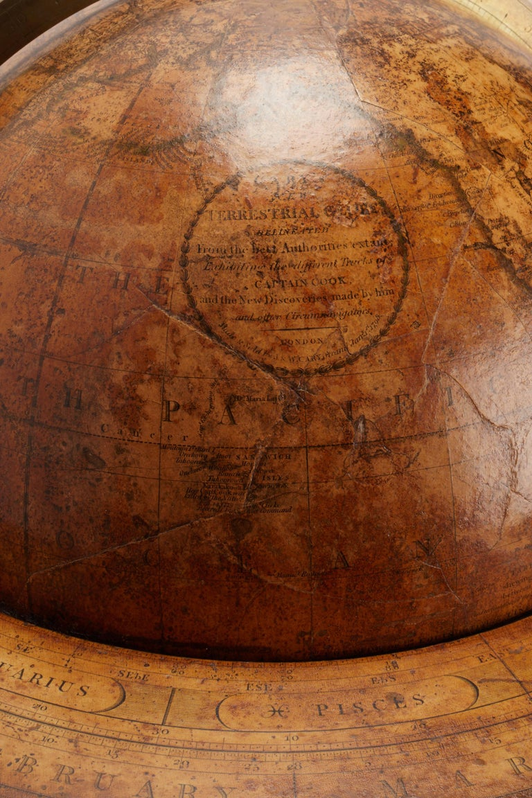 Large 'Papier Machè' terrestrial globe with gores printed in calcography a color finished, on a wooden tripod. One compass joints the three feet. Brass meridian. Maker CARY, London, England, circa 1798.