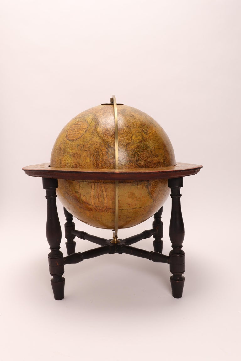 """Large 'Papier Machè' terrestrial globe ( 12"""" diameter ), with gores printed in calcography and color finished, on a wooden base. Maker CARY. London, England, circa 1800."""