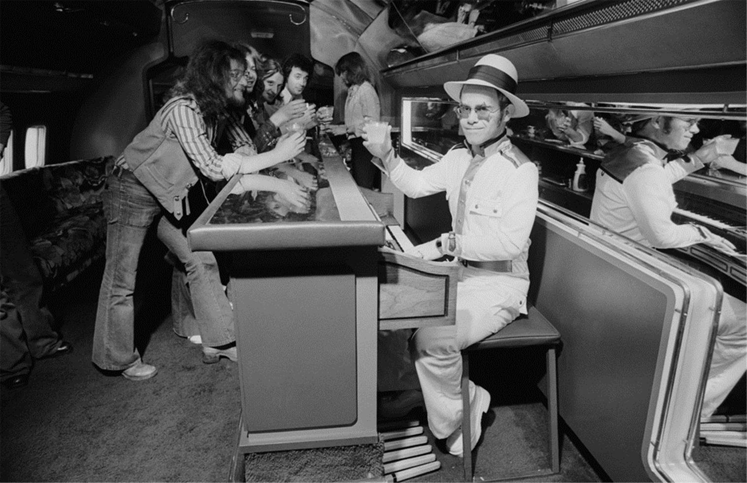 Elton John on airplane