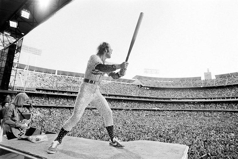Terry O'Neill Black and White Photograph - Elton John Dodger Stadium (Batting)