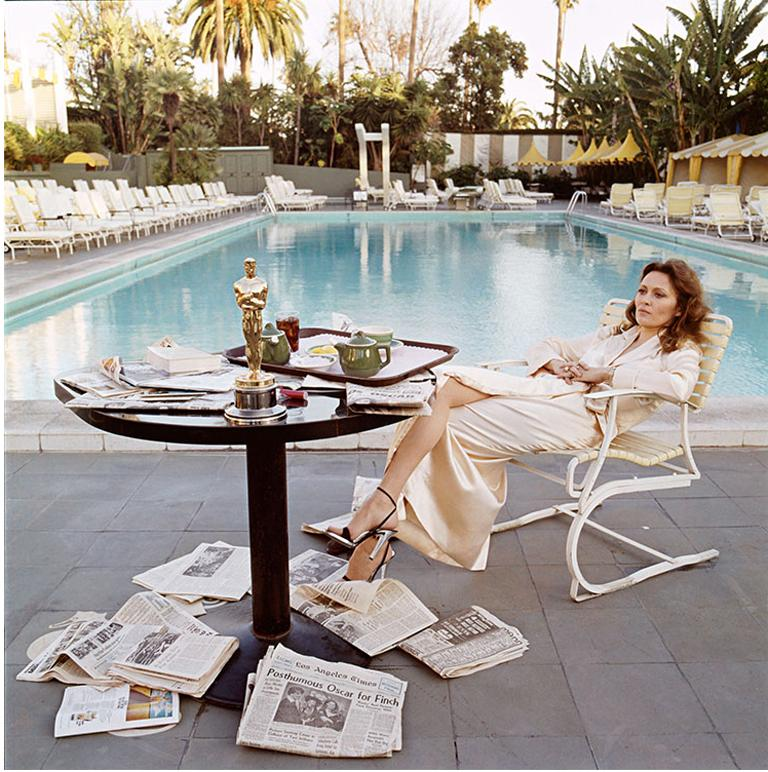 Faye Dunaway Oscar Ennui American actress Faye Dunaway takes breakfast by the pool with the day's newspapers at the Beverley Hills Hotel, 29th March 1977. She seems less than elated with her success at the previous night's Academy Awards ceremony,
