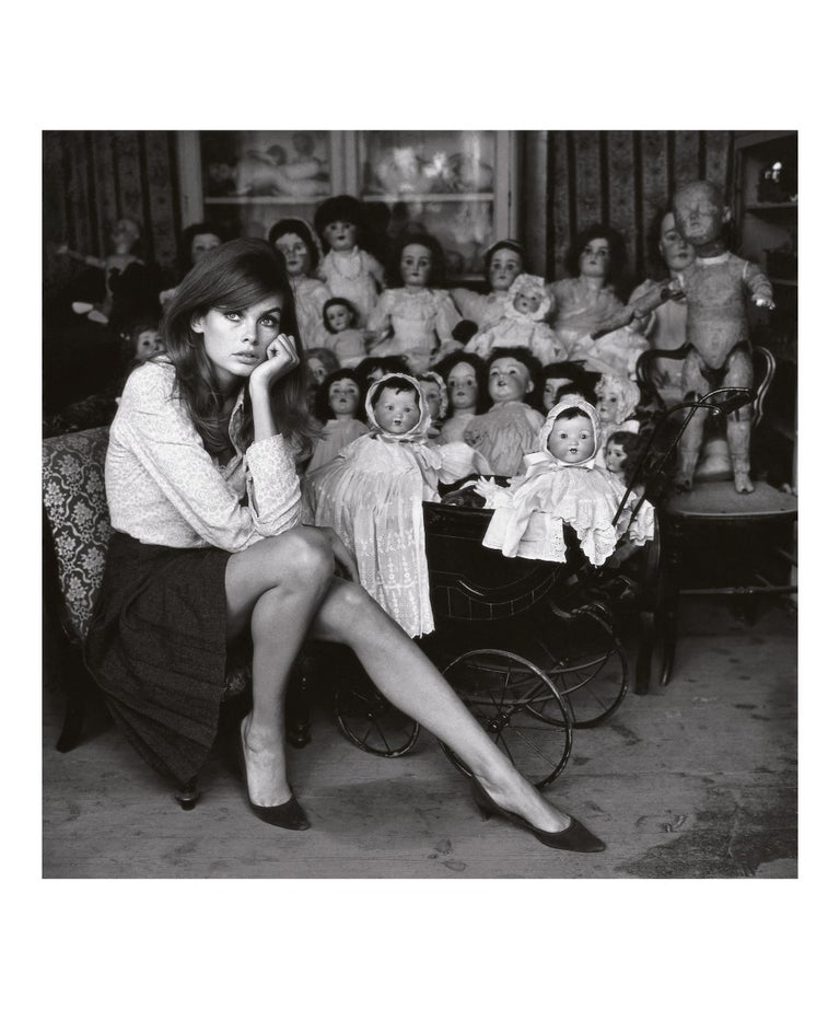 Jean Shrimpton at a Doll's Hospital, London - Terry O'Neill (Black and White) - Photograph by Terry O'Neill