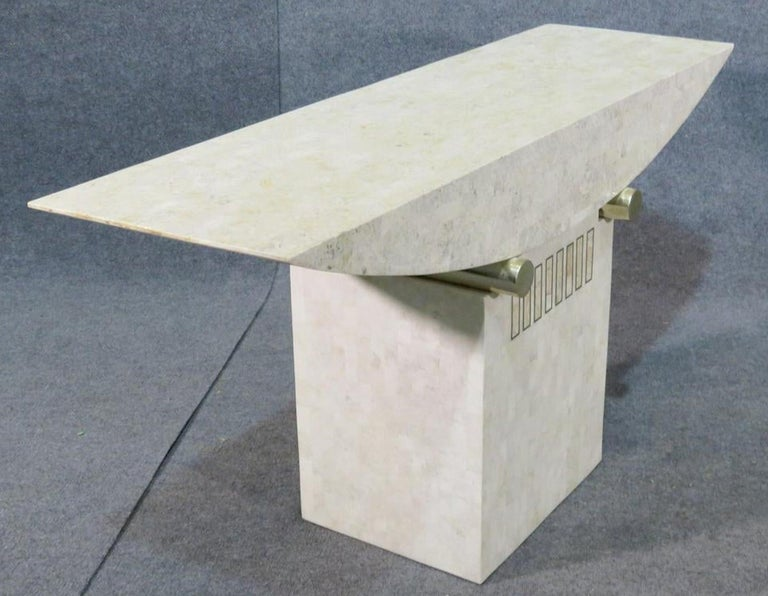 Midcentury console table with tessellated stone and brass accents.