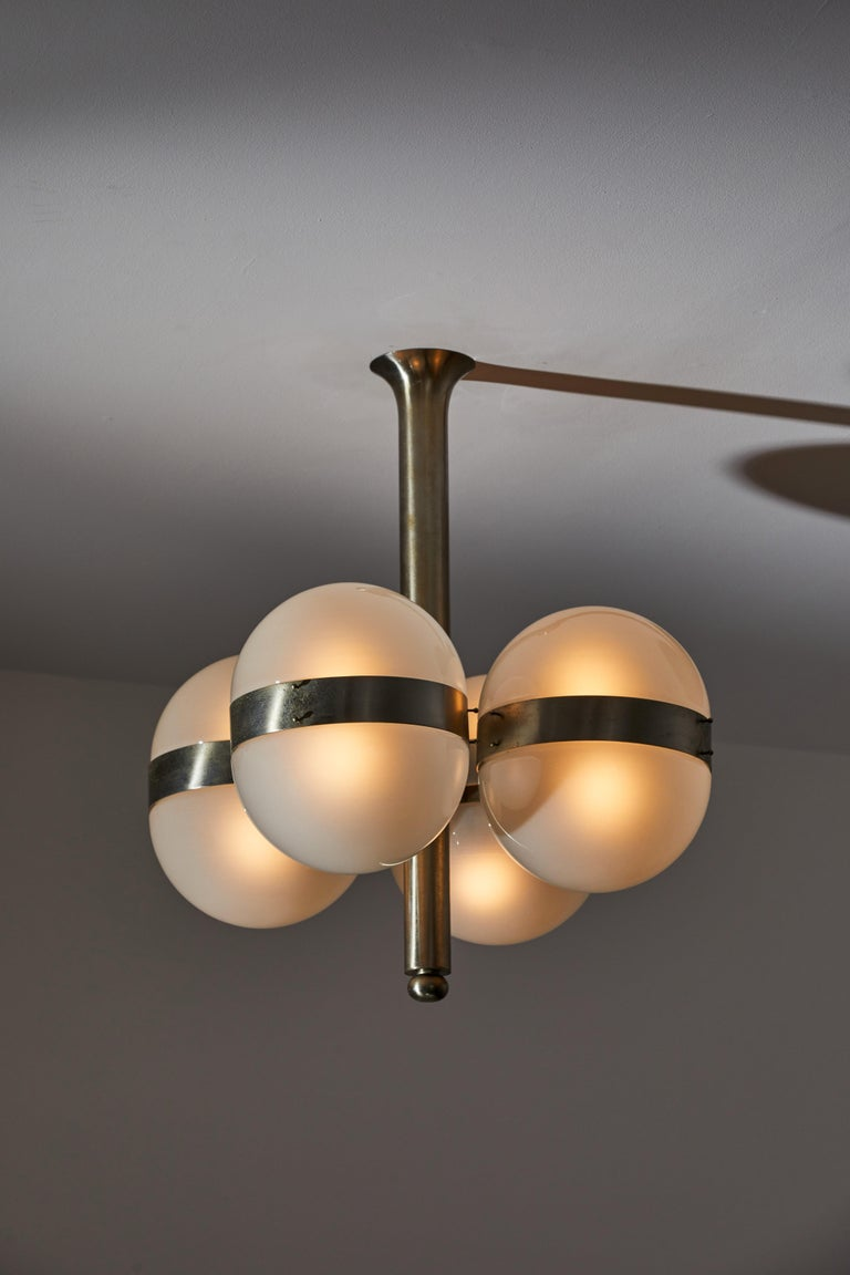 Tetraclio suspension light by Sergio Mazza for Artemide. Designed and manufactured in Italy, 1961. Nickel-plated brass, opaline glass. Rewired for U.S. standards. Takes eight E27 60w maximum bulbs. Bulbs provided as a onetime courtesy. Literature: