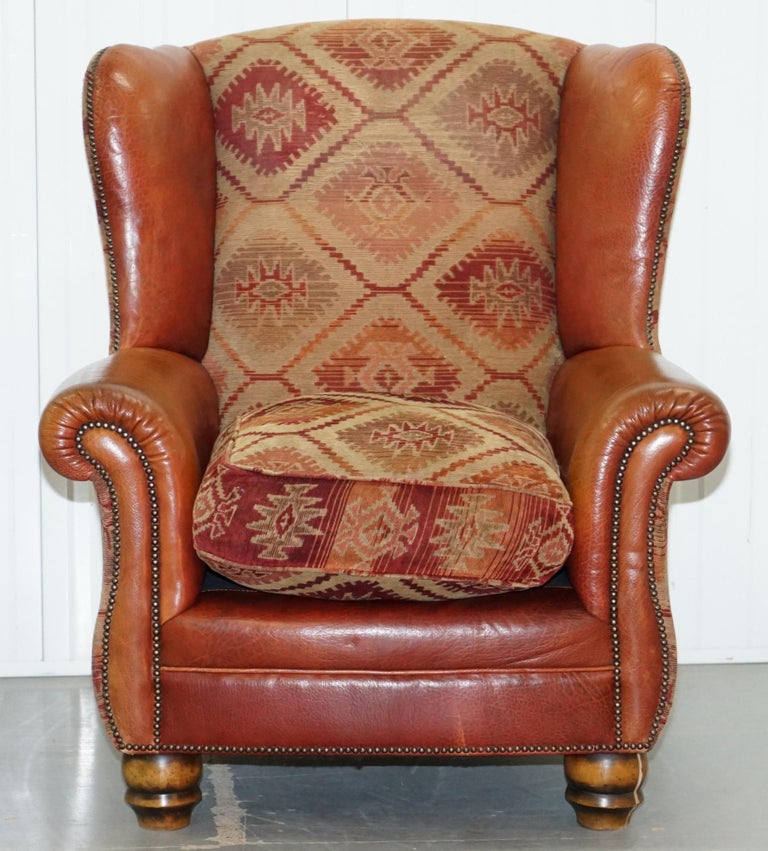 We are delighted to offer for sale this really lovely hand made in England Tetrad Eastwood brown leather armchair with Kilim upholstery RRP £1696.  The chair has a thick feather filled cushion, buffalo leather upholstery, the Kilim is thick and