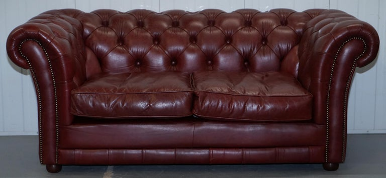 We are delighted to offer for sale this lovely reddish brown Tetrad Faded Glory hand made in England Chesterfield club sofa RRP £2699  The sofa is very comfortable, it has oversized arms and cushions and is allot easier to live with than a