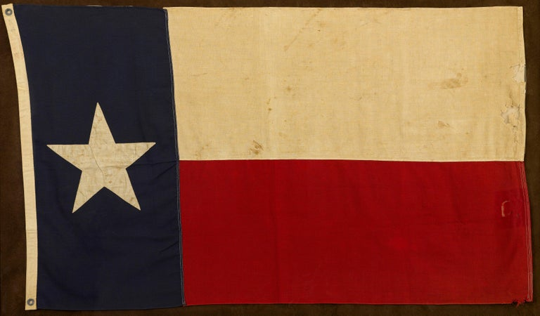 This is vintage Texas state flag, produced by Annin Flag Company in the 1930s. The flag is sewn and measures 3 ft x 5 ft.   Texas passed its Flag Act in 1933, describing the exact specifications for its flag. The Flag Act named blood red, azure