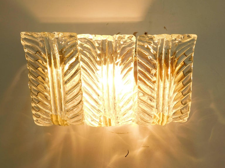 One of a kind Italian wall lights with three original vintage clear Murano glass leaves with textured details on newly made brass frames designed by Maria Maggi for Fabio Ltd. One light / E26 or E27 type / max 60W each Measure: Depth 6.5 inches,