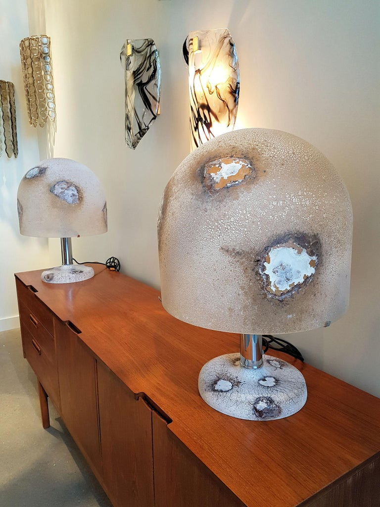 Large Murano glass table lamps, Mid-Century Modern, by Alfredo Barbini, Italy. Beautiful and unique textured and colored hand blown glass. Colors are revealed when lit. Chrome mounts, and Murano glass base. Designed and produced by Alfredo