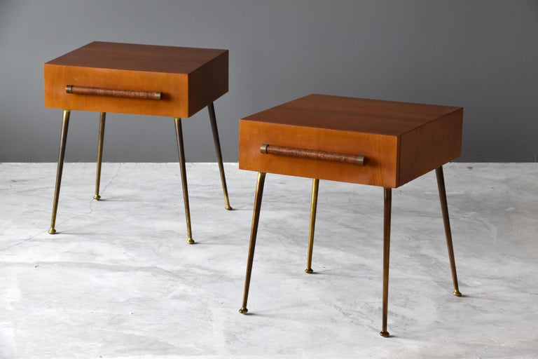 A pair of bedside cabinets / tables / nightstands / end tables designed by T.H. Robsjohn-Gibbings for Widdicomb furniture company. 