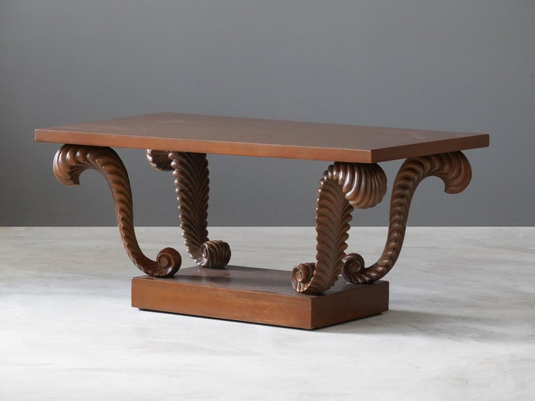 A rare coffee table or cocktail table. Designed by British / American designer T.H. Robsjohn-Gibbings. Produced by Widdicomb Furniture Company, Grand Rapids, Michigan. Bears stencil marking from Widdicomb as well as retail labels from John Stuart.