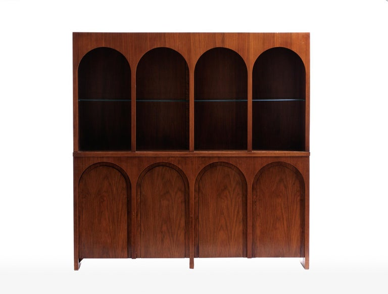Coliseum cabinet designed by T. H. Robsjohng-Gibbings for Widdicomb. Architectural display cabinet with illuminated interior, adjustable glass shelves, the cabinet doors echo the design of a coliseum. Price included refinishing. Widdicomb label in
