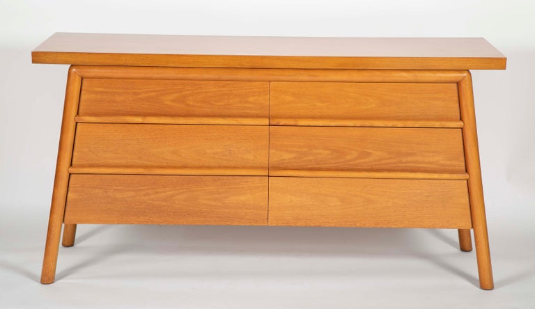 T.H. Robsjohn-Gibbings credenza bleached Mahogany six-drawer credenza with slab top and canted legs.