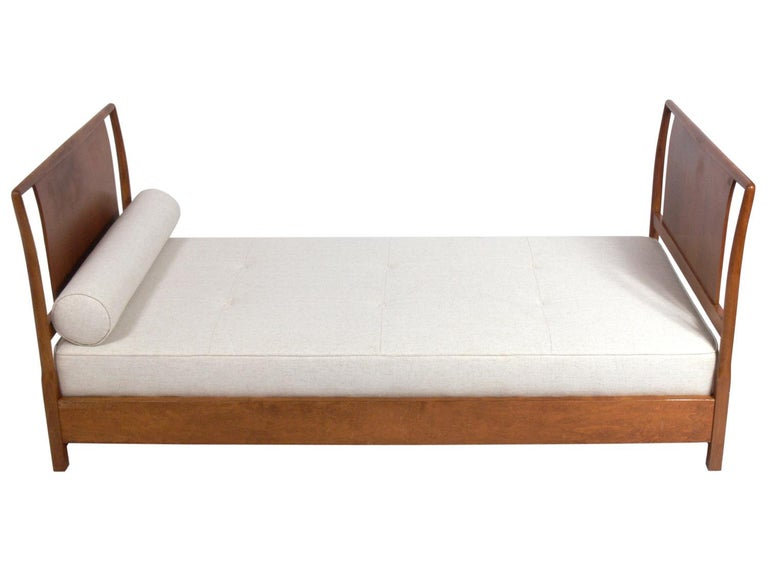 Elegant daybed, designed by T.H. Robsjohn-Gibbings for Widdicomb, American, circa 1950s. This daybed is currently being refinished and can be completed in your choice of color. The price noted below includes refinishing. It has been reupholstered in