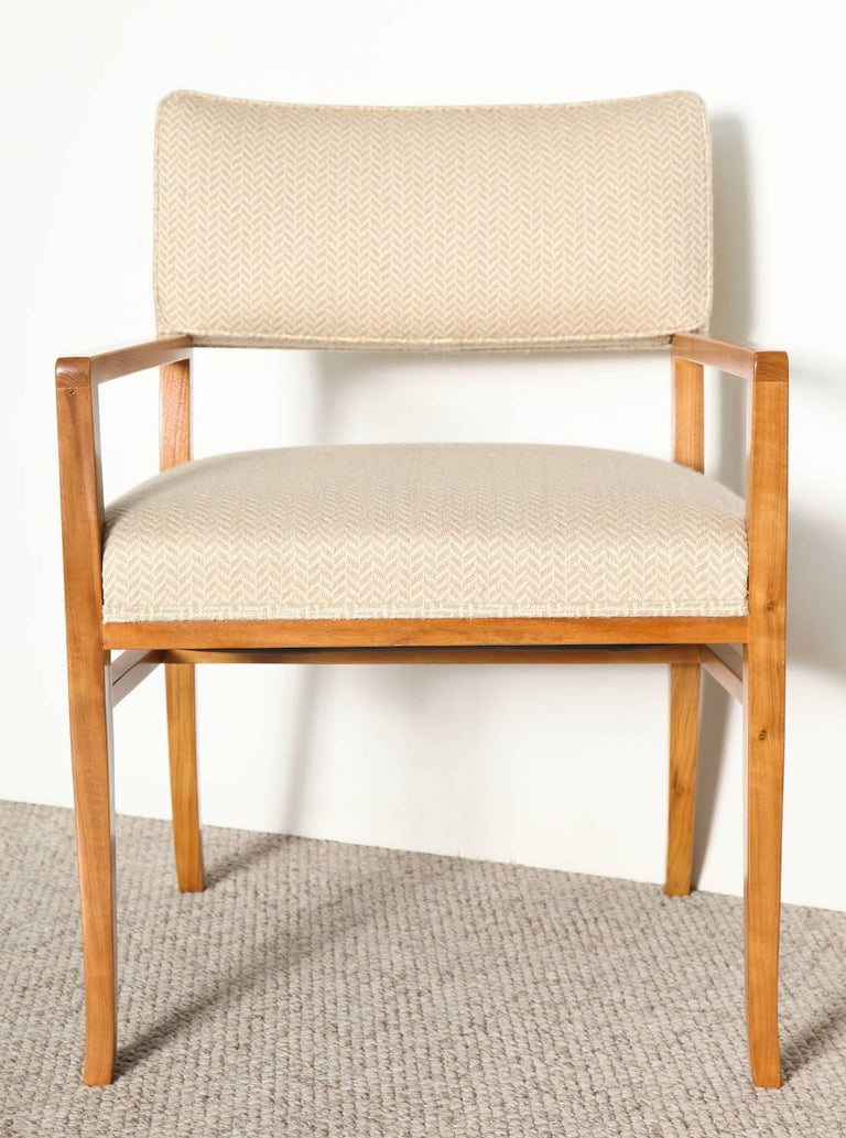 Rare set of two custom designed armchairs by T. H. Robsjohn-Gibbings. These chairs with upholstered seats and backs, frame in bleached walnut with curved back legs. This form predates Gibbings' collaboration with Widdicomb and shows up in his custom